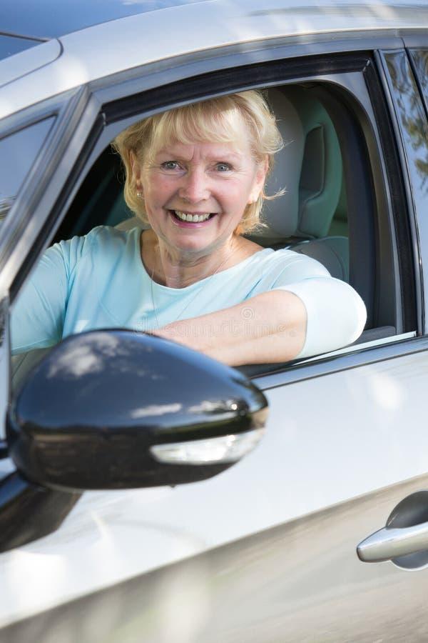Portrait Of Smiling Senior Woman Driving Car. Smiling Senior Woman Driving Car stock photo
