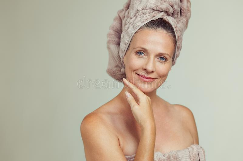 Beautiful mature woman in towel stock photography