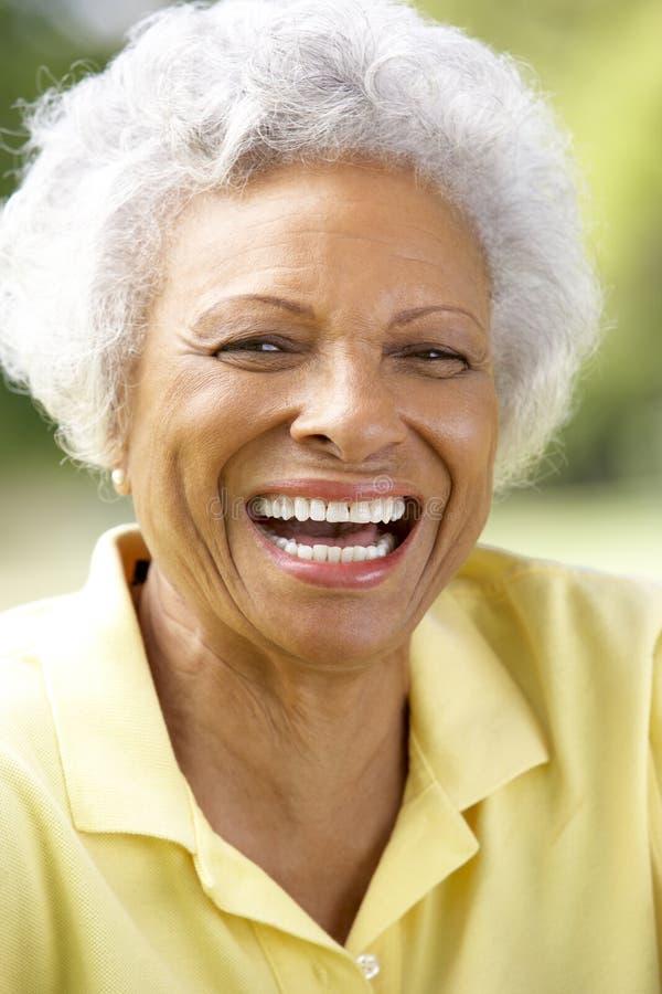 Portrait Of Smiling Senior Woman Outdoors stock photo