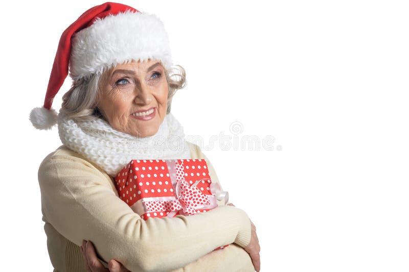 Portrait of smiling senior woman in Santa hat posing royalty free stock image