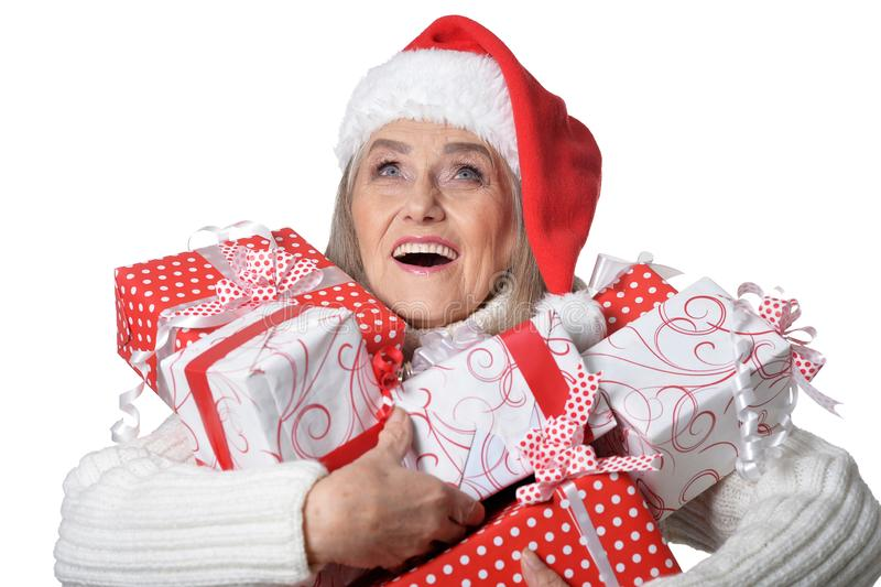 Portrait of smiling senior woman in Santa hat posing stock photos