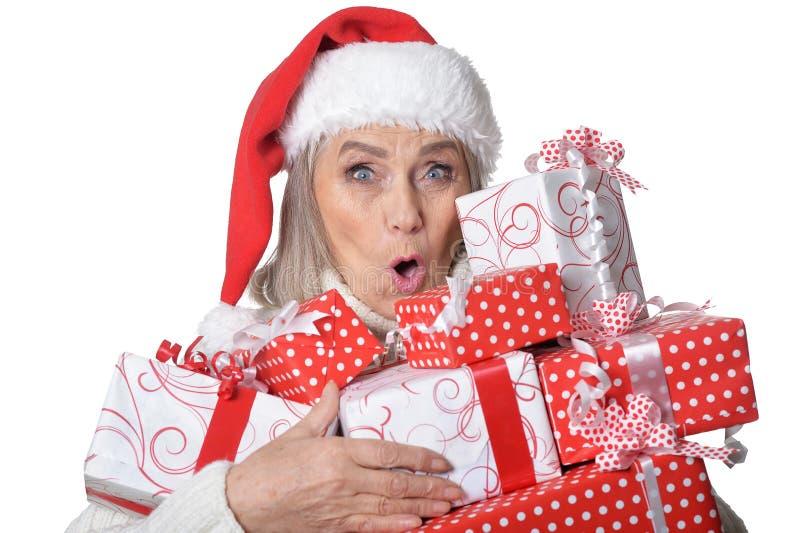 Portrait of smiling senior woman in Santa hat posing stock photo
