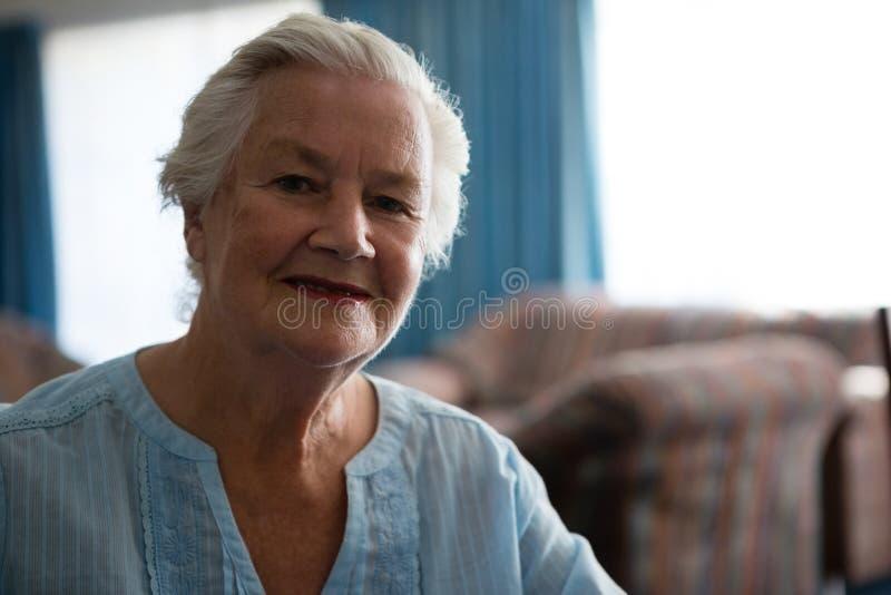 Portrait of smiling senior woman stock images