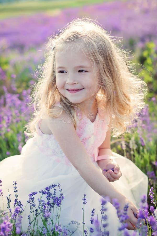 Portrait smiling toddler girl. Smiling toddler girl in lavender field stock photo
