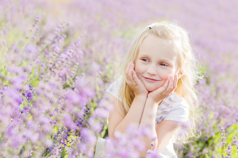Portrait smiling toddler girl in lavender. Field royalty free stock images