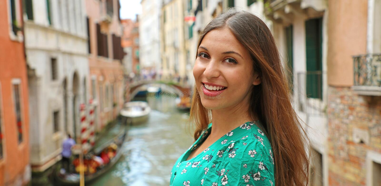 Portrait of smiling travel tourist woman in Venice, Italy. Panoramic banner view of girl having fun traveling outdoors during stock photos