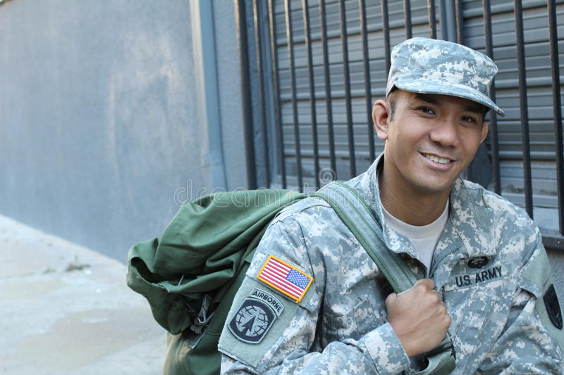 The portrait of the smiling US Army soldier with copy space on the left royalty free stock photo