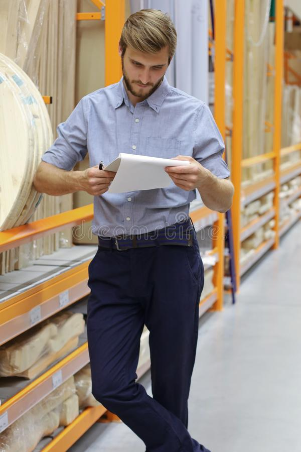 Portrait of a smiling warehouse keeper at work.  royalty free stock photos
