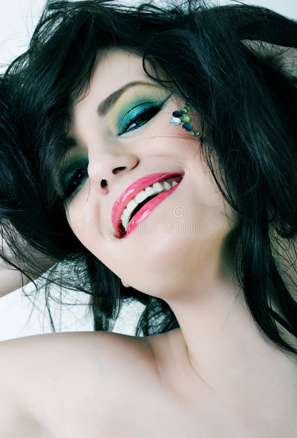 Portrait of smiling woman with colorful makeup stock image