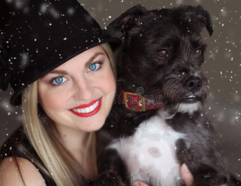 Portrait of Smiling Woman With Dog in Winter royalty free stock photos