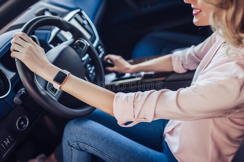 Woman driving new car royalty free stock images