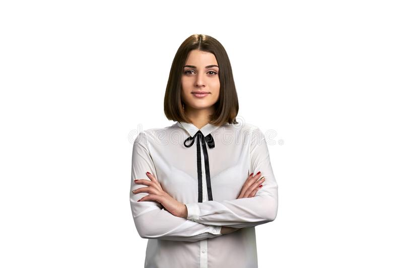 Portrait of smiling woman with folded arms. Young caucasian woman in formal wear crossed arms on white background stock image