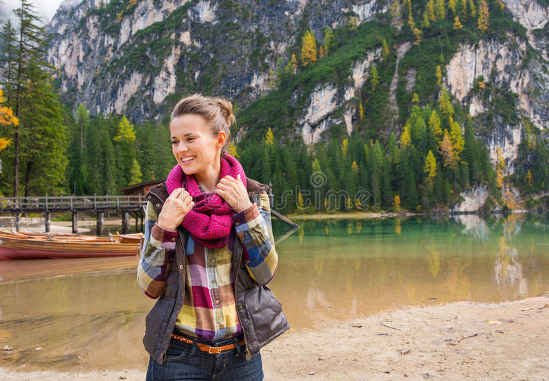 Portrait of smiling woman on Lake Bries readjusting scarf royalty free stock images