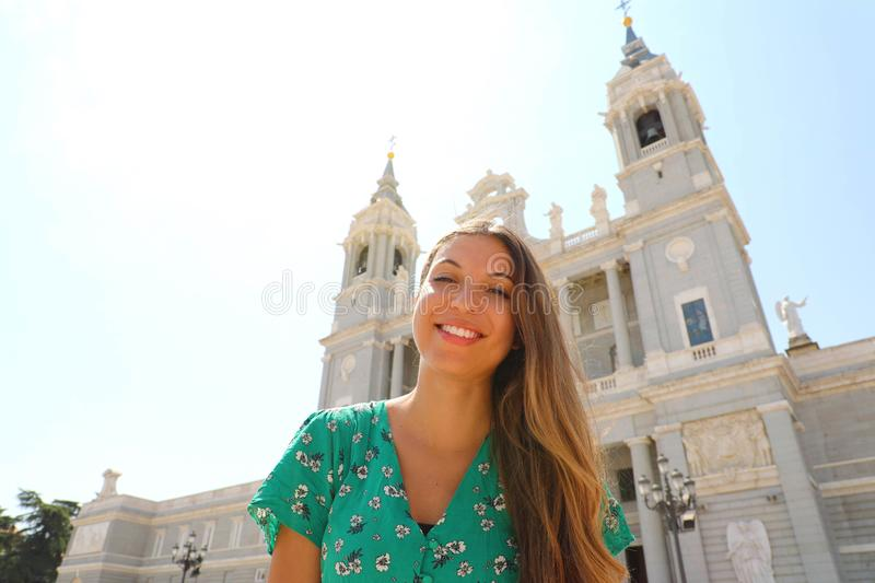 Portrait of smiling woman in Madrid with Almudena Cathedral on the background, Spain stock images