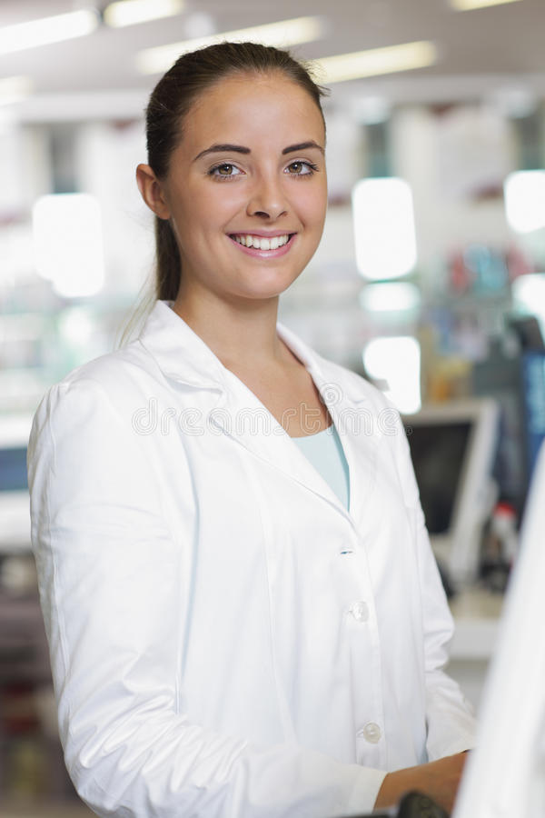 Portrait of Smiling Woman Pharmacist in Pharmacy royalty free stock photography