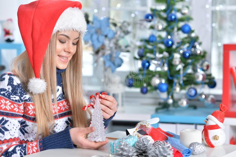 Portrait of cute smiling woman preparing for Christmas stock photography