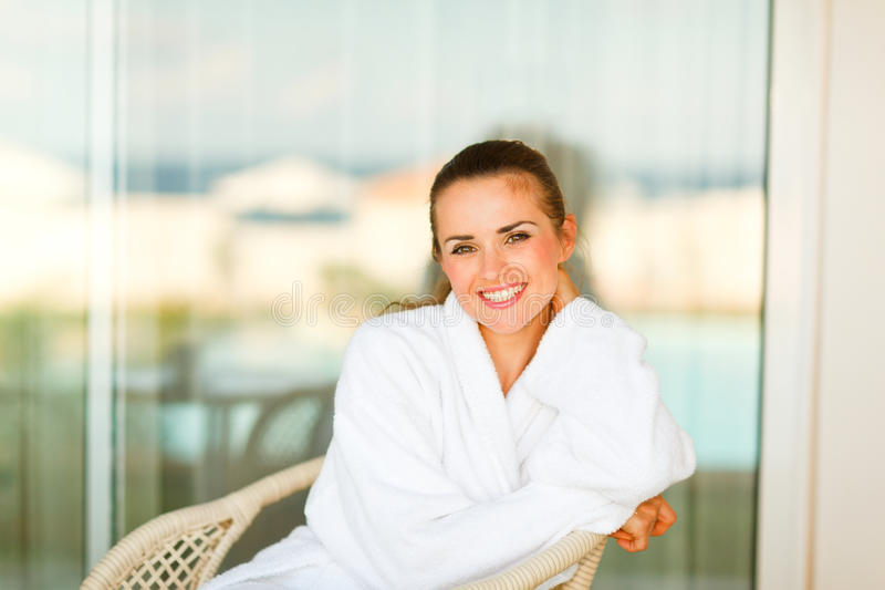 Download Portrait Of Smiling Woman Sitting On Terrace Stock Photo - Image: 21981386