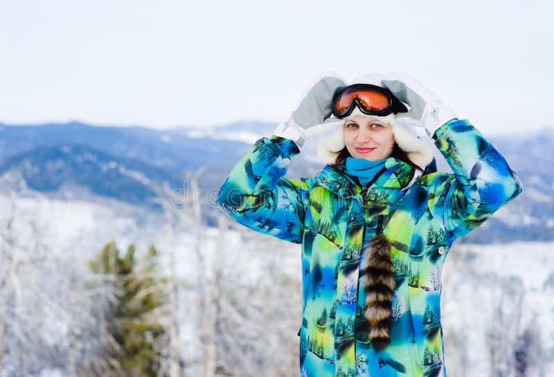 Portrait of smiling woman with sunglasses for skiing royalty free stock photos
