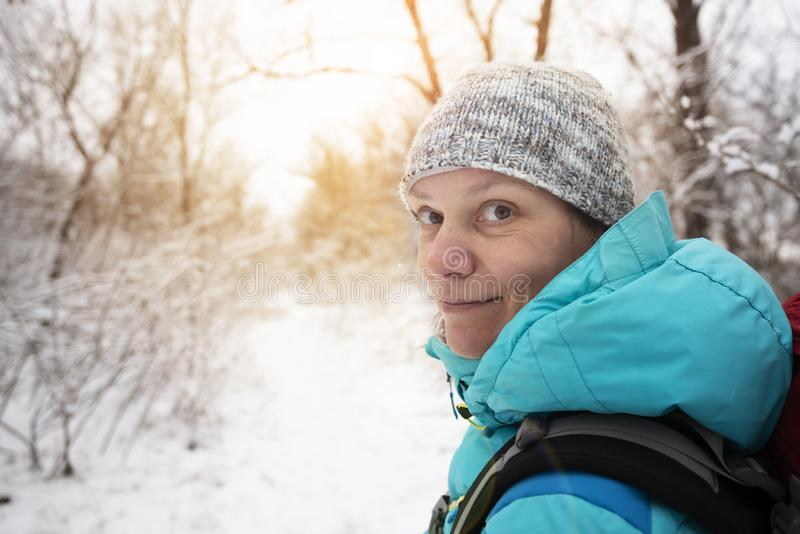 Portrait of smiling woman on the trail in the forest royalty free stock photo