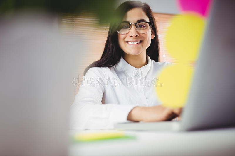 Portrait of smiling woman working in office royalty free stock photos