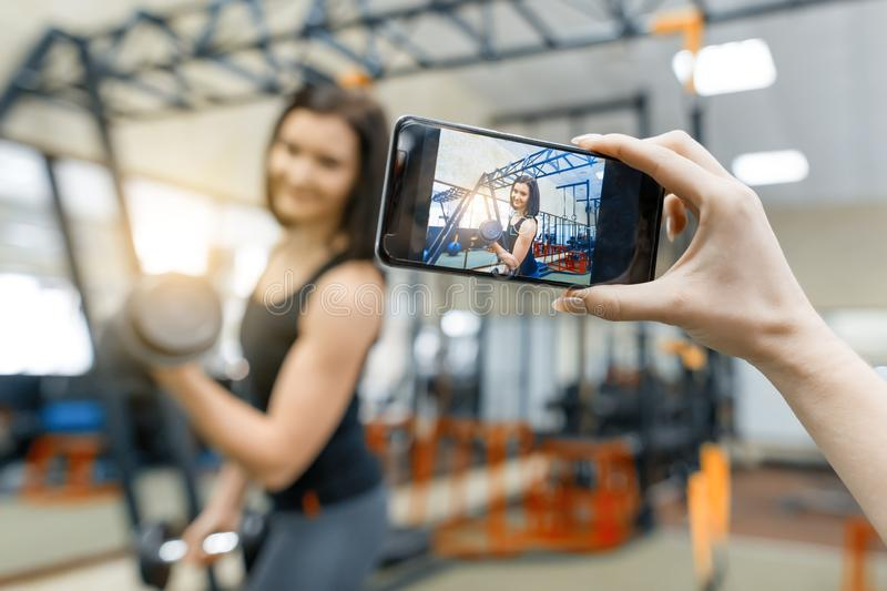 Portrait of smiling young beautiful caucasian fitness woman in gym, female looking at camera. Fitness, sport, training, people, royalty free stock photography