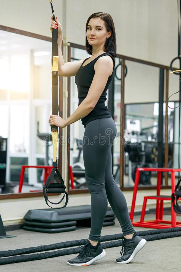 Portrait of smiling young beautiful caucasian fitness woman in gym, female looking at camera. Fitness, sport, training, people, stock photography