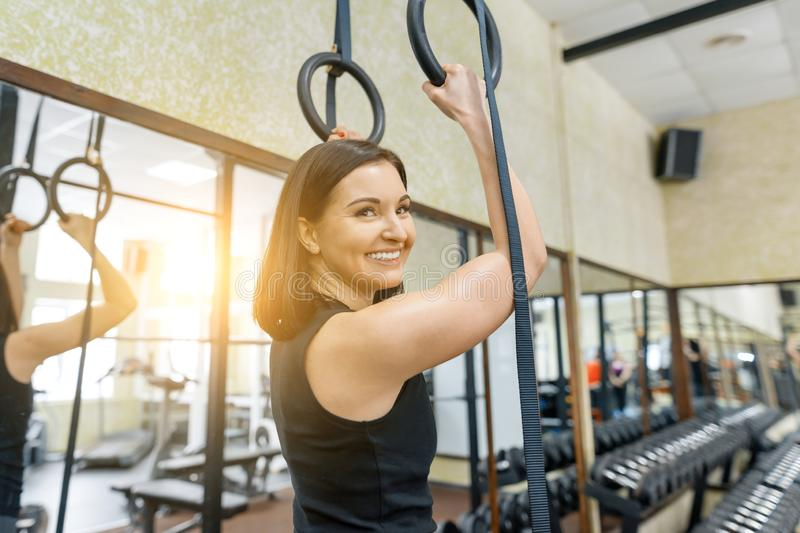 Portrait of smiling young beautiful caucasian fitness woman in gym, female looking at camera. Fitness, sport, training, people, stock images
