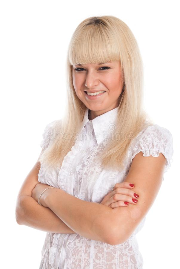 Portrait of a smiling young blonde with arms crossed isolated stock images