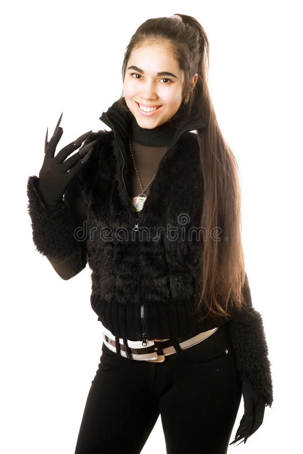 Portrait of smiling young brunette in gloves stock photo