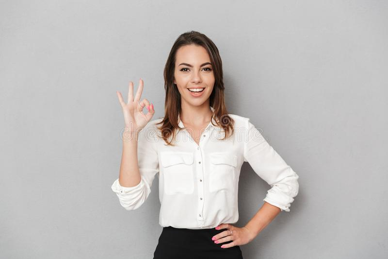 Portrait of a smiling young business woman royalty free stock photos