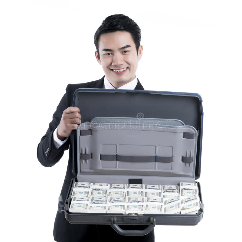 Portrait of smiling young businessman holding a briefcase with d royalty free stock images