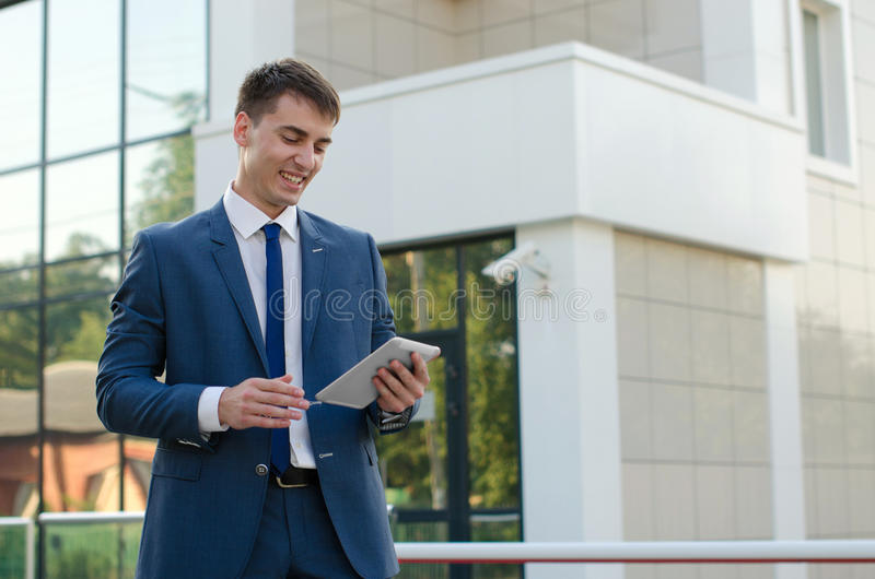 Portrait of smiling young businessman stock image