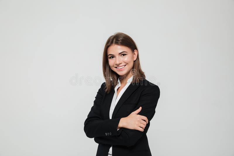 Portrait of smiling young businesswoman in suit royalty free stock photo