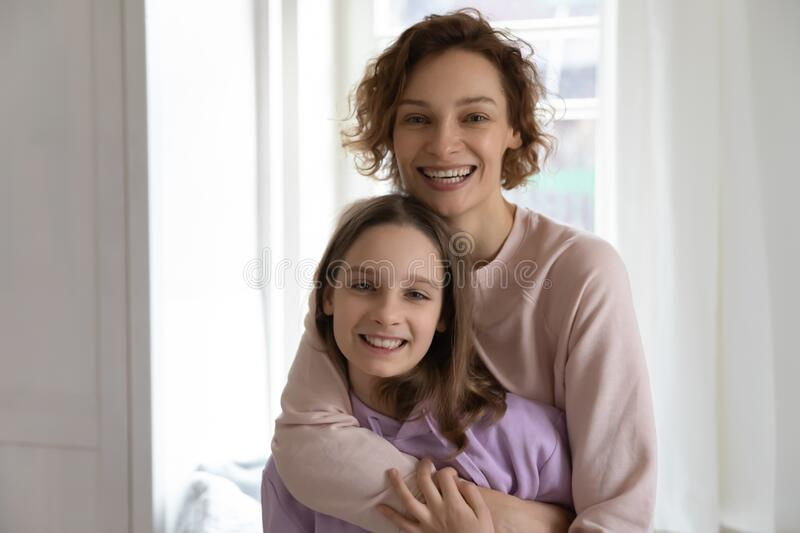 Happy Mother And Daughter In Bed, Smiling Hugging Royalty