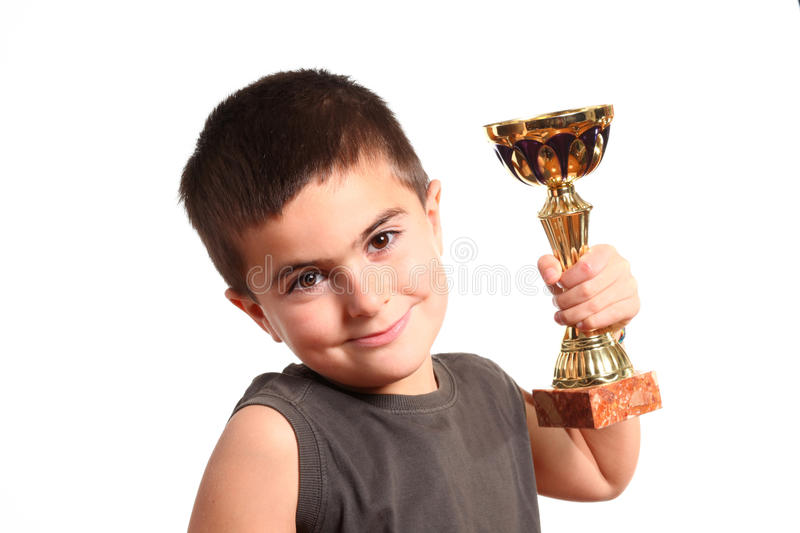 Portrait of a smiling young champion with trophy. Portrait of a smiling young champion with his trophy isolated on white background royalty free stock image