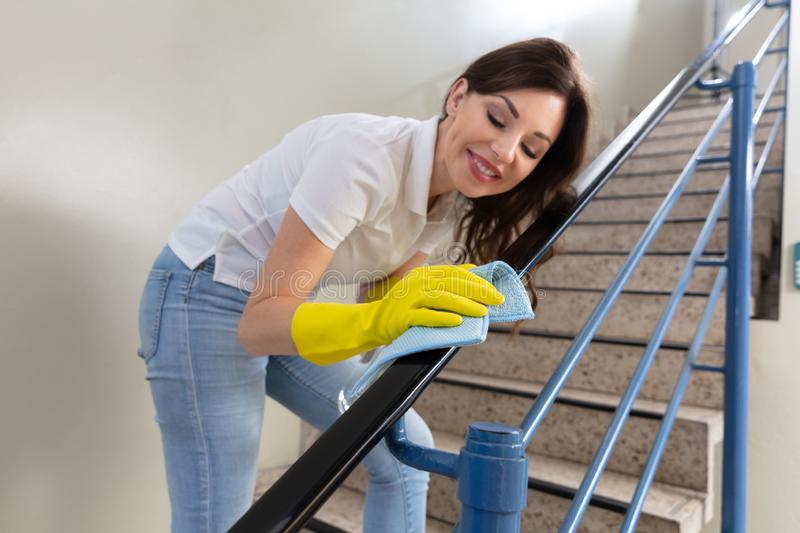 Female Janitor With Spray Bottle stock photography