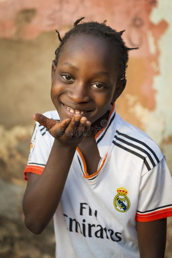 Portrait of a smiling young girl at the Cupelon de Cima neighborhood in the city of Bissau, Guinea Bissau. Bissau, Republic of Guinea-Bissau - January 31, 2018 royalty free stock images