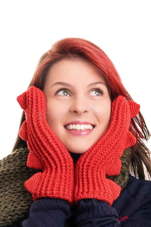 Portrait of a smiling young girl in winter clothes stock photo