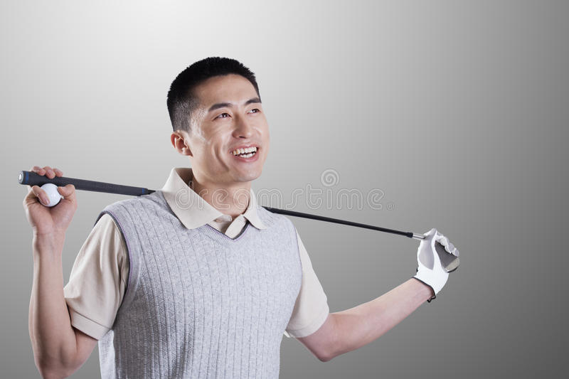 Portrait of smiling young golf player royalty free stock photography