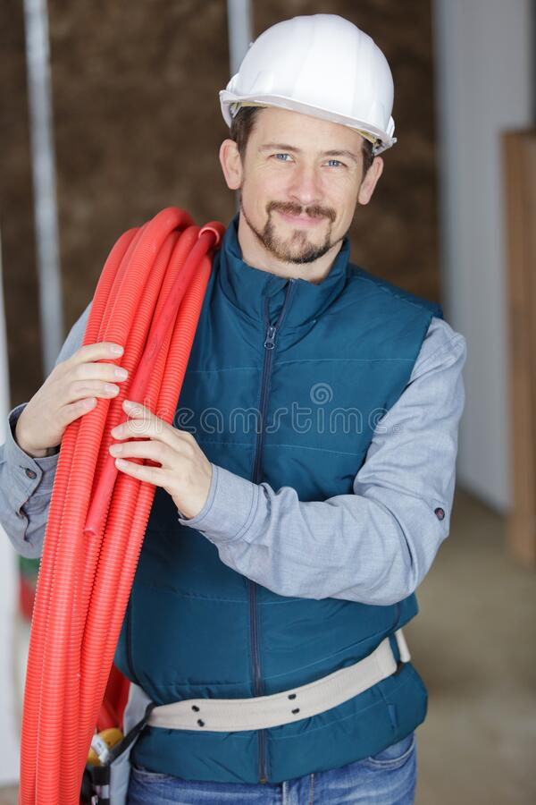 Portrait smiling young male plumber stock photo