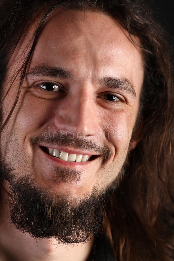 Download Portrait Of Smiling Young Man With Long Hair Stock Image - Image: 10484365