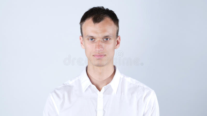 Portrait of smiling young man in the studio stock photo