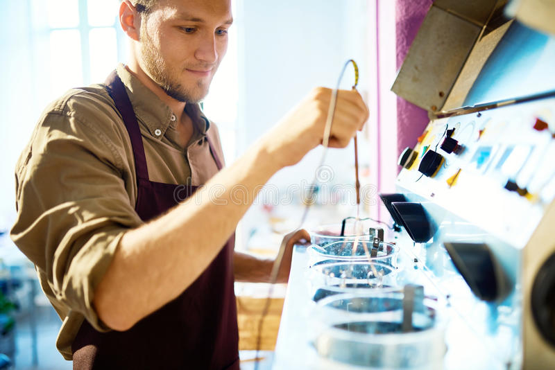 Young Man Working with Machine royalty free stock image