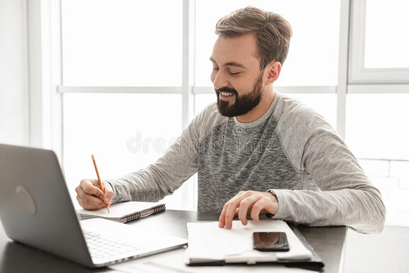 Portrait of a smiling young man working stock photo
