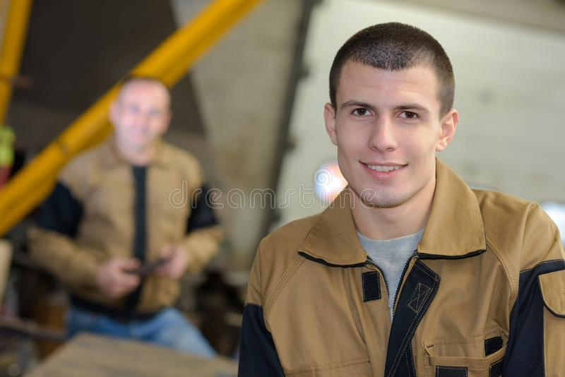 Portrait smiling young tradesman in uniform stock photos
