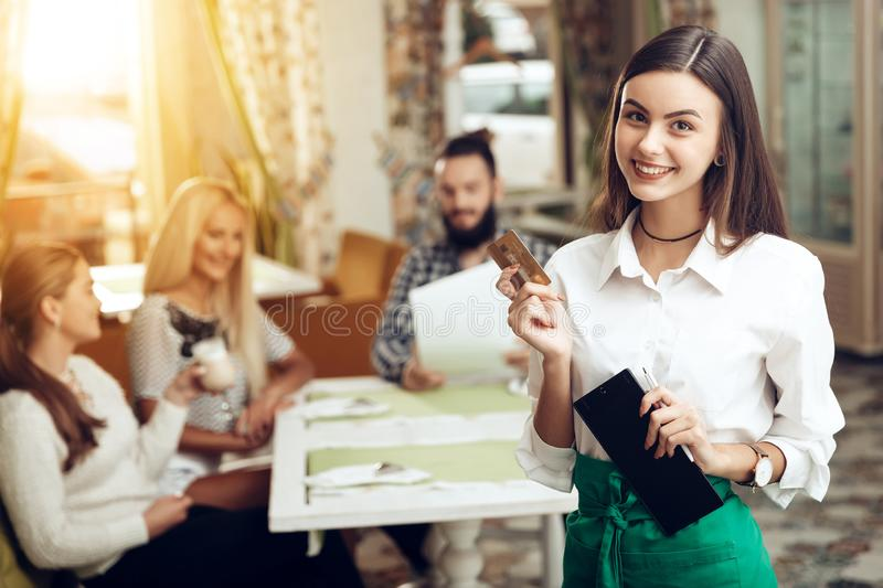 Portrait smiling young waitress standing in cafe royalty free stock image