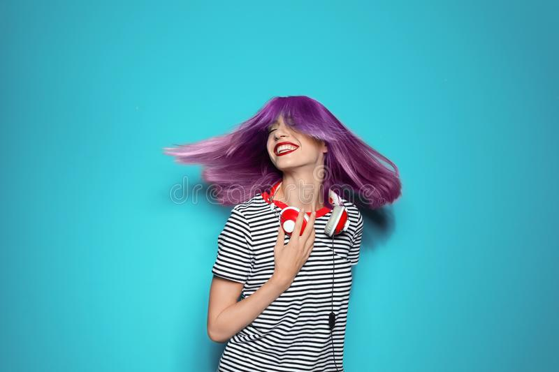 Portrait of smiling young woman with dyed straight hai stock photo