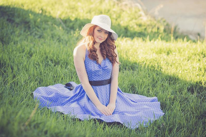 Portrait of a Smiling Young Woman in Grass royalty free stock photography