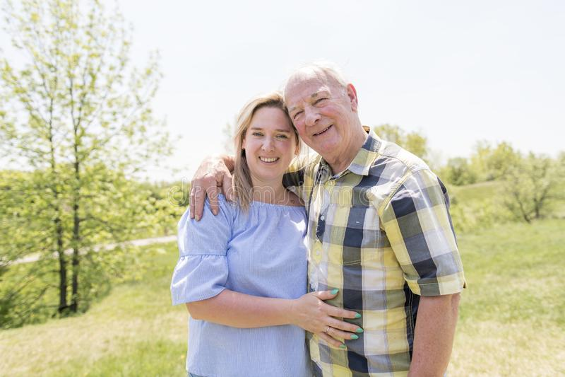 Portrait Of A Smiling Young Woman With Her senior Father royalty free stock image