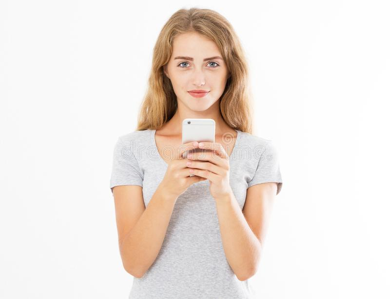 Portrait of a smiling young woman holding mobile phone isolated on white background, chatting girl,advertising concept,copy space royalty free stock image